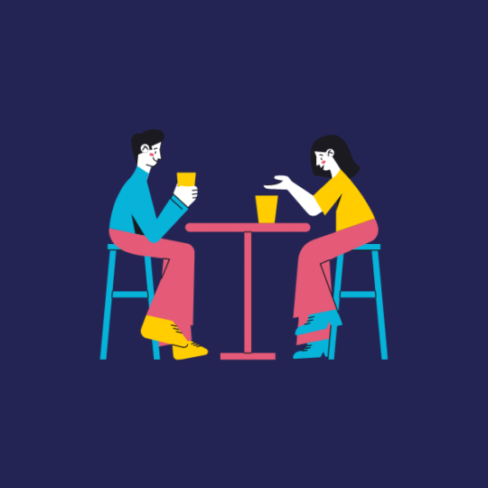 People discussing at a table